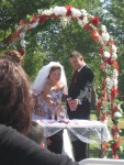Vows, pouring sand into a vase to symbolize unity